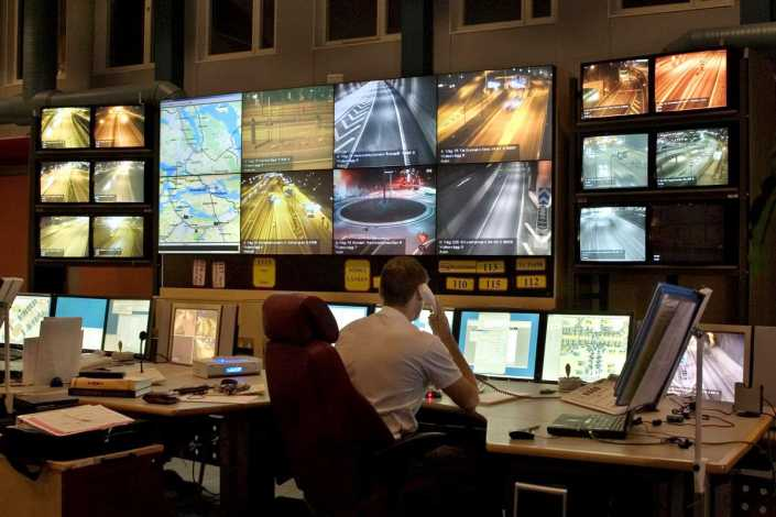 A control room with monitors.