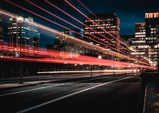 Traffic at night in a city. Photo by Marc-Olivier Jodoin on Unsplash